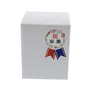 A.タテ型 白箱に漢字のコサージュシールを貼った実例画像